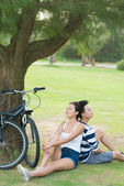 Young couple relaxing after biking — Stock Photo