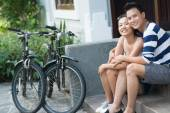Vietnamese couple resting on porch — Stock Photo