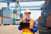 Dock worker controlling working process — Stock Photo