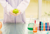 Scientist with green apple — Stock Photo