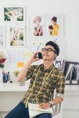 Asian tailor talking on phone — Stock Photo