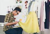 Dressmaker looking for color — Stock Photo