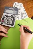 Bookkeeper counting monthly income — Stock Photo
