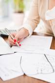 Female accountant working with papers — Stock Photo