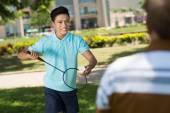 Vietnamese teenager playing badminton — ストック写真