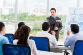 Businessman conducting seminar for colleagues — Stock Photo