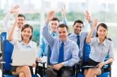 Business people raising hands — Stock Photo
