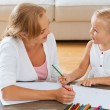 Mother and daughter enjoying drawing — Stock Photo #54320315