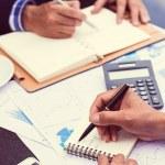 Businessman writing down his timetable — Stock Photo #54321551