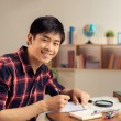 Asian student doing homework — Stock Photo #54322409