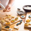 Decorating Halloween cookies — Stock Photo #54323353