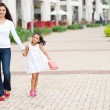 Mother and daughter with shopping bags — Stock Photo #54324145