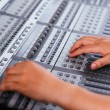 Adjusting audio mixing console — Stock Photo #54324909