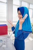 Asian woman talking on telephone — Stock Photo
