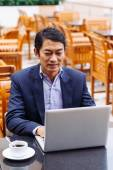 Middle-aged Asian manager — Stock Photo