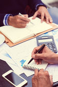 Businessman writing down his timetable — Foto Stock