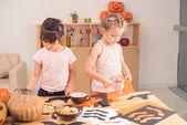 Two little girls cutting bats — Stock Photo