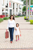 Mother walking with her daughter — Stock Photo