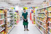 Hispanic man in supermarket — Stock Photo