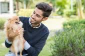 Man with Pomeranian spitz — Stock Photo