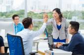 Asian manager giving high five — Stock Photo