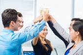 Successful business team clinking glasses — Stock Photo
