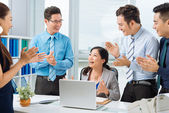 Business people applauding female colleague — ストック写真