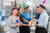 Vietnamese coworker exchanging presents — Stock Photo