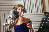 Woman recording song — Stock Photo