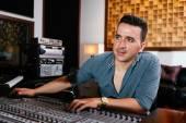 Sound engineer at music mixer — Stock Photo
