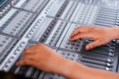 Adjusting audio mixing console — Stockfoto
