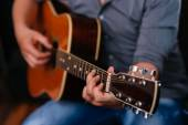Playing acoustic guitar — Stock Photo