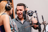 Duet singing in recording studio — Stock Photo