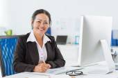 Senior manager working with papers — Stock Photo
