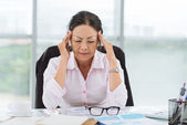 Business woman having headache — Stock Photo
