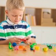 Boy molding from colored plasticine — Stock Photo #56937975