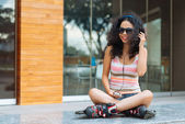 Skater in headphones — Stock Photo