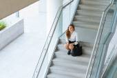Female office worker sitting on steps — Stock Photo
