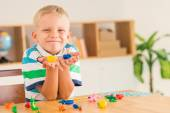 Child showing clay article he made — Stock Photo