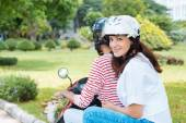 Couple riding a moped — Stock Photo