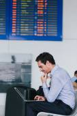 Businessman at waiting room of the airport — Stock Photo