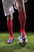 Legs of footballer — Stock Photo