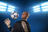 Goalkeeper hitting the ball — Foto Stock