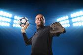 Goalkeeper throwing the ball — Stock Photo