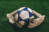 Ball and gloves — Stock Photo