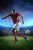 Soccer player dribbling in match — Stock Photo