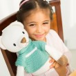 Girl with knitted bear — Stock Photo #59256979
