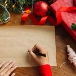 Writing Christmas greetings — Stock Photo #59356677