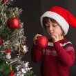 Decorating Christmas tree — Stock Photo #59536233
