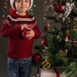 Boy with a Christmas ball — Stock Photo #59536439